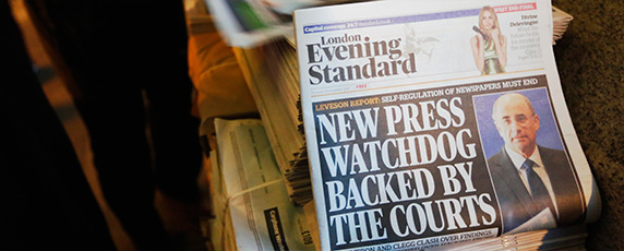 The News of the World scandal, in which the British Sunday tabloid hacked voicemails of celebrities and ordinary citizens, led to a divisive debate on how to regulate the media in the U.K. (Reuters/Luke MacGregor)
