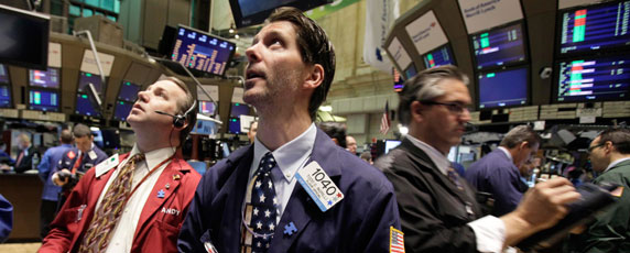 Sharp swings in the stock market have led to questions about who stands to benefit from high-frequency trading. (AP/Richard Drew)