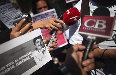 Mexican journalists speak in a news conference, protesting the abduction and murder of journalist Gregorio Jiménez de la Cruz. (Reuters/Edgard Garrido)