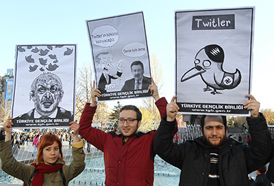 Turkish citizens hold signs protesting Twitter being blocked in the country. (AFP/Adem Altan)