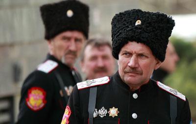Cossacks stand guard near the Crimean parliament building in Simferopol, March 6. (Reuters/David Mdzinarishvili)