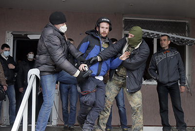 British photojournalist Frederick Paxton is roughed up while reporting in the town of Horlivka. (AP/Efrem Lukatsky)