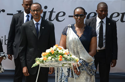 Rwandan President Paul Kagame and First Lady Janet Kagame lay a wreath at a genocide memorial in Kigali on April 7. (AFP/Simon Maina)