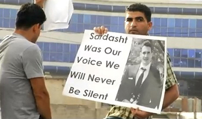 A protester demonstrates against the killing of Sardasht Osman. (YouTube/FilmBrad)
