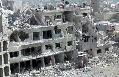 An image taken by the Shaam News Network, a Damascus-based citizen news organization, shows buildings damaged by heavy shelling. (AP/Shaam News Network)