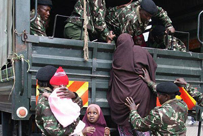 Somali families are boarded onto lorries from Eastleigh, Nairobi, and sent to one of two refugee camps. (Mohamed Adow)