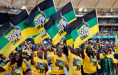 Supporters of President Jacob Zuma's ruling ANC party cheer at their final election rally in Soweto, May 4. South Africans go to the polls on Wednesday. (Reuters/Mike Hutchings)