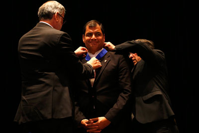 Rafael Correa is awarded an honorary doctorate by Santiago University in Chile on May 14, 2014. Four newspapers face fines for not covering the event sufficiently. (Reuters/Ivan Alvarado)