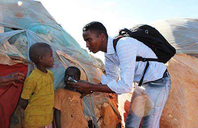 Yusuf Keynan, who was killed by a car bomb in June, is seen here speaking to internally displaced persons. (Abdukhader Ahmed)