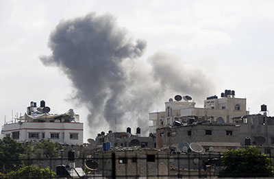 Smoke billows from a Gaza City neighborhood after an Israeli airstrike. (AFP/Mohammed Abed)