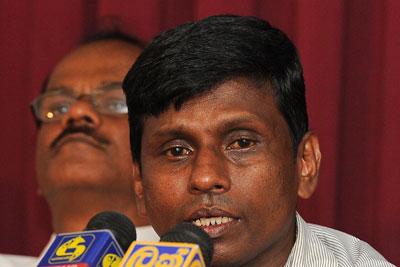 Sunil Jayasekera, convener of the Sri Lankan Free Media Movement, talks to journalists in Colombo in June. (AFP/Lakruwan Wanniarachchi)