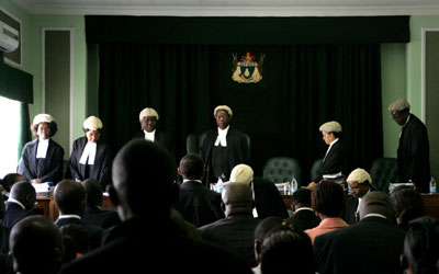 Zimbabwe's Constitutional Court's decision to strike down criminal defamation must be implemented. (AFP/Jekesai Njikizana)