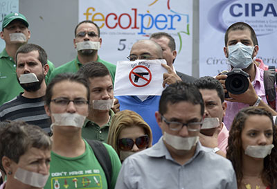 Journalists protest the murder of Colombian reporter Luis Carlos Cervantes. (AFP/Raul Arboleda)