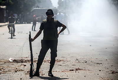 A police officer is seen in Cairo amid clashes between security forces and supporters of the Muslim Brotherhood. (AFP/Mohamed el-Shahed)