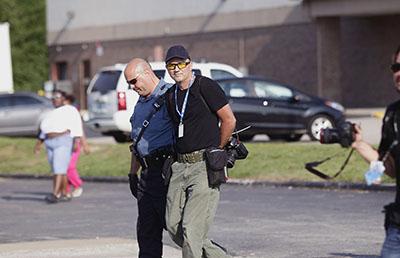 Police in Ferguson, Missouri, arrest Scott Olson, a photographer for Getty Images. (Reuters/Joshua Lott)
