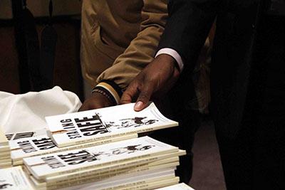 Journalists take copies of the Kenyan security manual. (Zoe Mwende)