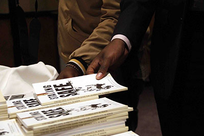 Journalists take copies of the Kenyan security manual. (Zoe Mwende)
