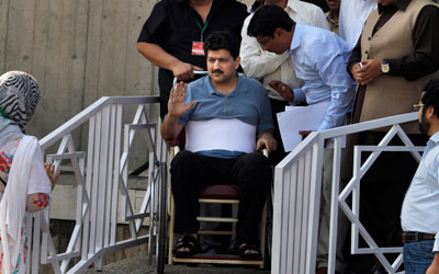 Pakistani journalist Hamid Mir was hit by six bullets in April and, more recently, a new round of threats. (AP/Anjum Naveed)