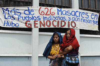 Survivors of Guatemala's civil war protest in May 2013 after General José Efraín Ríos Montt's conviction for genocide was quashed. A new trial for the former dictator is due to start in January. (AFP/Johan Ordonez)
