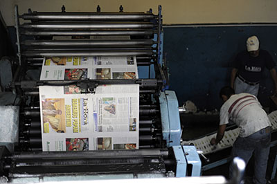 A printing press in Guatemala. Journalists there say covering sensitive issues is risky. (AFP/Johan Ordonez)