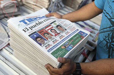 Newspapers covering the election of Juan Orlando Hernández are stacked up. (Reuters/Jorge Cabrera)