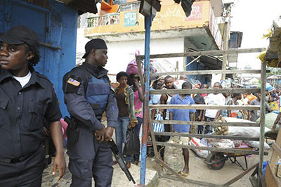 Security forces guard a checkpoint in an area of Monrovia that was in quarantine for several days as part of government efforts to try to contain Ebola in Liberia. (Reuters)