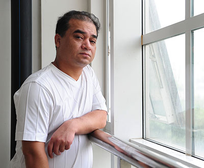 Uighur blogger Ilham Tohti, pictured in Beijing in 2010, has been sentenced to life in prison. (AFP/Frederic J. Brown)