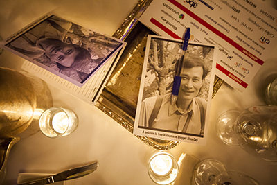 Petitions calling for the release of Nguyen Van Hai are scattered across a table at the CPJ International Press Freedom Awards. Hai is serving a 12-year sentence for blogging. (Michael Nagle/Getty Images for Committee to Protect Journalists/AFP)