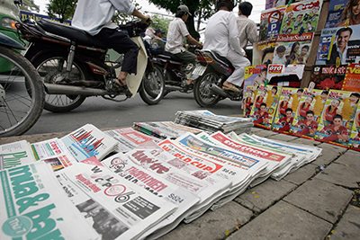 Newspapers are stacked on a Ho Chi Minh City street. The country's state-run press is heavily censored, reporters say. (AFP/Hoang Dinh Nam)