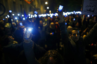 People protesting in Budapest about a new Internet tax on data use hold up their smartphones. (Reuters/Laszlo Balogh)