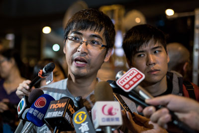Student leaders speak to the press at a pro-democracy protest outside the central government offices in Hong Kong on Thursday. (AFP/Alex Ogle)