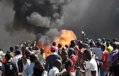 Protesters demonstrate against a proposed amendment to Burkina Faso's constitution that would allow President Blaise Compaore to extend his term. (AFP/Issouf Sanogo)