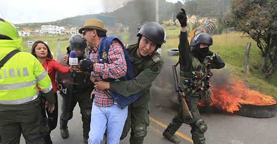 A reporter tries to interview a protester being taken away by police during clashes near Bogotá in 2013. Violence against journalists in Colombia has generally waned, and with it, journalist deaths. (Reuters/Jose Miguel Gomez)