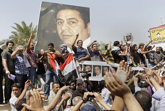 Protesters demonstrate against the killing of Iraqi journalist Hadi al-Mehdi, who was shot dead in 2011. No one has been held responsible. (AP/Karim Kadim)