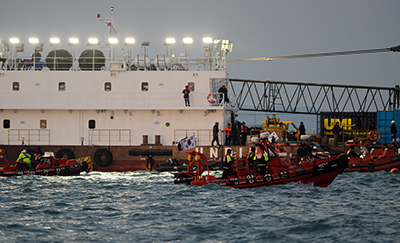 A Japanese reporter has been charged with defamation after criticizing the South Korean president in connection with the deadly Sewol ferry disaster in April, seen here. (AFP/Nicolas Asfouri)