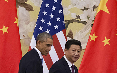 President Xi Jinping, pictured right, with Barack Obama at a Beijing press conference on November 12, where he was questioned about visa restrictions for the foreign press. (AFP/Mandel Ngan)