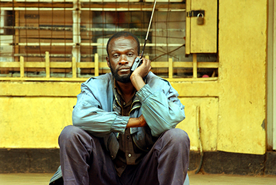 A man listens to the news on the radio, a popular form of media for many Rwandans. (AFP/Marco Longari)