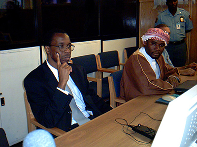 Ferdinand Nahimana, left, of RTLM, and Hassan Ngeze, right, editor of Kangura, in December 2003. A U.N. tribunal found them guilty of using the media to incite genocide. (AFP/Stella Vuzo)