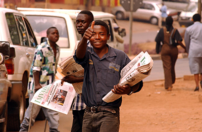 A Rwandan sells papers in Kigali. As stability returned to the country, a series of new publications flooded the market. (AFP/Marco Longari)