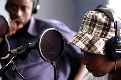 Journalists prepare to air the first broadcast from the privately owned Radio 10 in 2004. Radio is thriving in Rwanda but the memory of how broadcasts were used to incite genocide has led to tight regulations. (AFP/Gianluigu Guercia)
