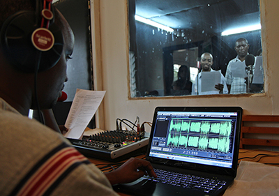 Radio 10 journalists air the privately owned station's first broadcast in 2004. Radio is thriving in Rwanda, especially in the local language. (AFP/Gianluigu Guercia)