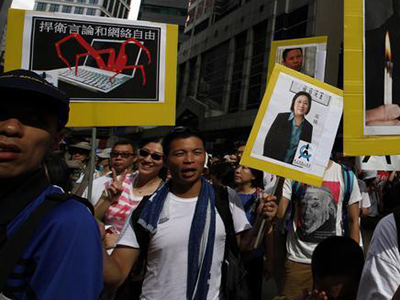 Protesters carry a placard of jailed journalist Gao Yu at a demonstration in Hong Kong in July. (Reuters/Bobby Yip)