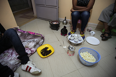 Journalists who fled to Nairobi over security fears perform a traditional Ethiopian coffee ceremony in one of the cramped apartments they share. (CPJ/Nicole Schilit)