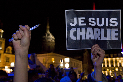 A vigil in France for victims of the Charlie Hebdo attack. In cities across the world, pens and signs reading I Am Charlie were held aloft in honor of those killed in the gun attack. (AFP/Thierry Zoccolan)