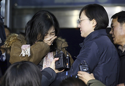 Korean-America writer and talk show host Shin Eun-mi is deported from South Korea after making positive comments about North Korea. (AP/Yonhap Shin Joon-hee)