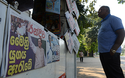 Newspapers announce the election victory of Maithripala Sirisena, who has pledged to improve conditions for the press in Sri Lanka. (AFP/Lakruwan Wanniarachchi)