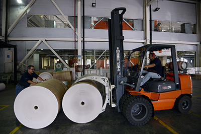 Rolls of donated newsprint are delivered to papers in Caracas. The country's press is struggling to have supplies imported. The shortage has forced the daily Correo del Caroní to cut its page numbers. (AFP/Juan Barreto)
