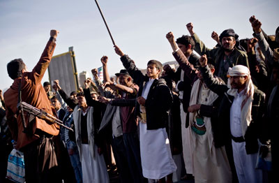 Houthi Yemenis chant slogans during a rally to show support for their comrades in Sana'a, Yemen, on Wednesday. (AP/Hani Mohammed)