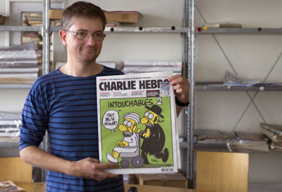 Charb, the chief editor of the the satirical weekly Charlie Hebdo, is shown holding the front page of the newspaper in 2012. Charb was shot dead today in Paris. (AFP/Fred Dufour)