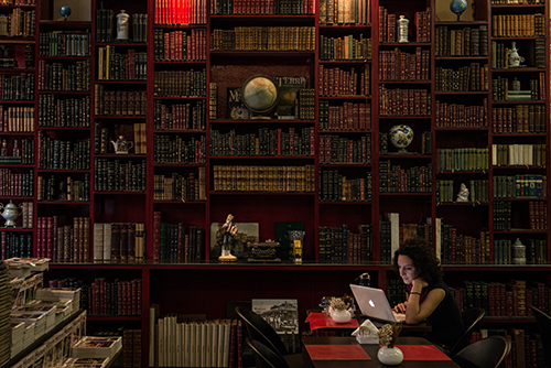 A woman uses a laptop at a café in a Rio de Janeiro bookstore. Two bloggers in Brazil say they received threats after reporting on crime and inequality. (AFP/Yasuyoshi Chiba)